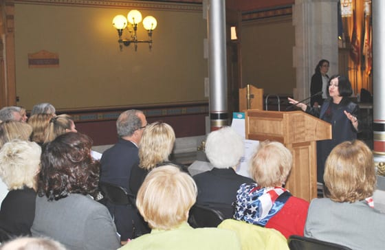 State Senator Toni Boucher (at podium) on Apr. 29 welcomed area realtors to the State Capitol to mark Realtor Day.